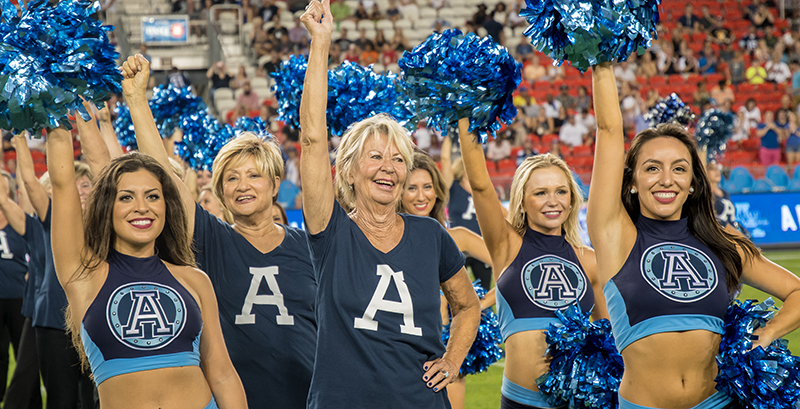 Argos alumni cheerleaders performing wearing custom printed t-shirts.