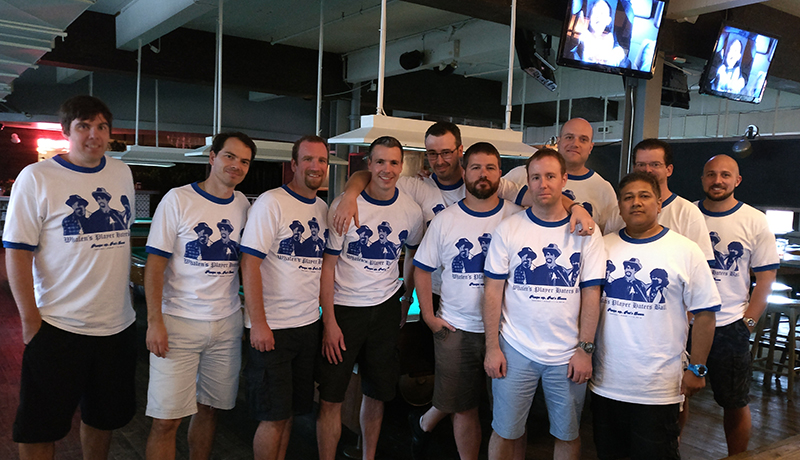 Customized t-shirts for bachelor party with custom design on white and blue lining t-shirt.