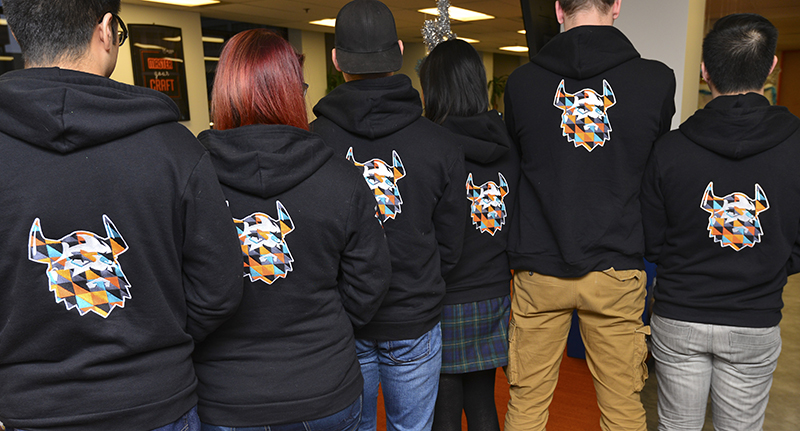 Entripy clients posing with their black custom hoodies 2d335f93a99a