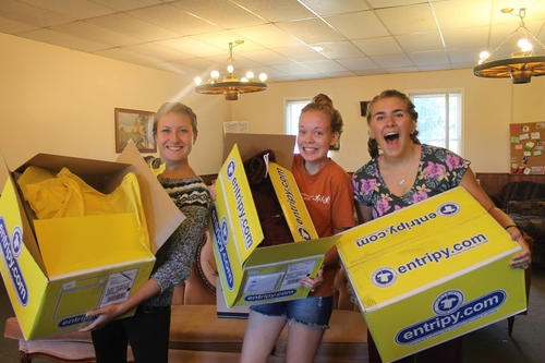Consumers excited to receive their custom designed merch from entripy in the yellow box.