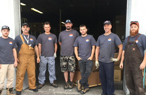 Employees wearing construct company custom t-shirt with their company logo.