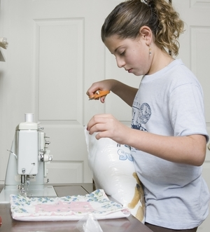 A girl customizing a Pillow with her old tshirts