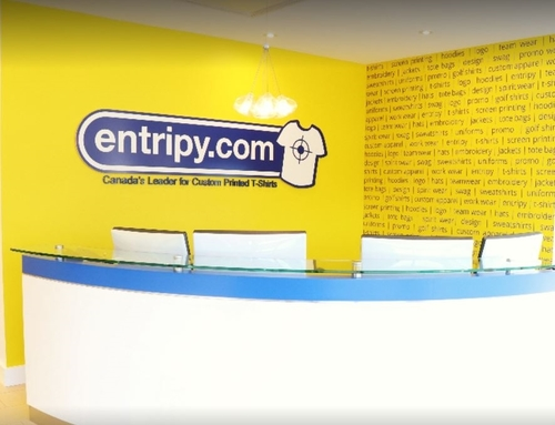 Entripy company reception with yellow bright creative wall at the back