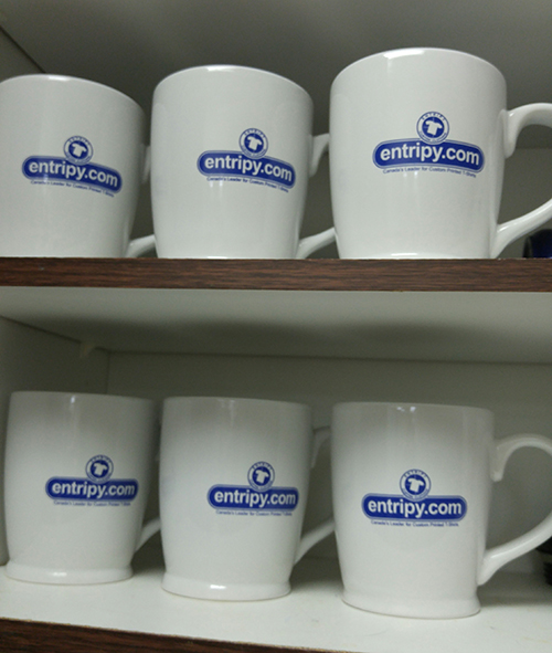 Entripy branded custom mugs displayed for client and employee use.