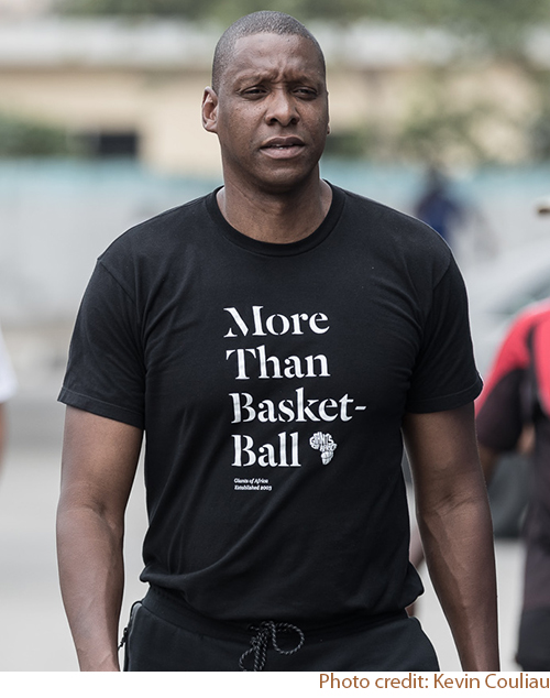 Masai Ujiri, founder of Giants of Africa wearing a black custom t-shirt with their custom design.