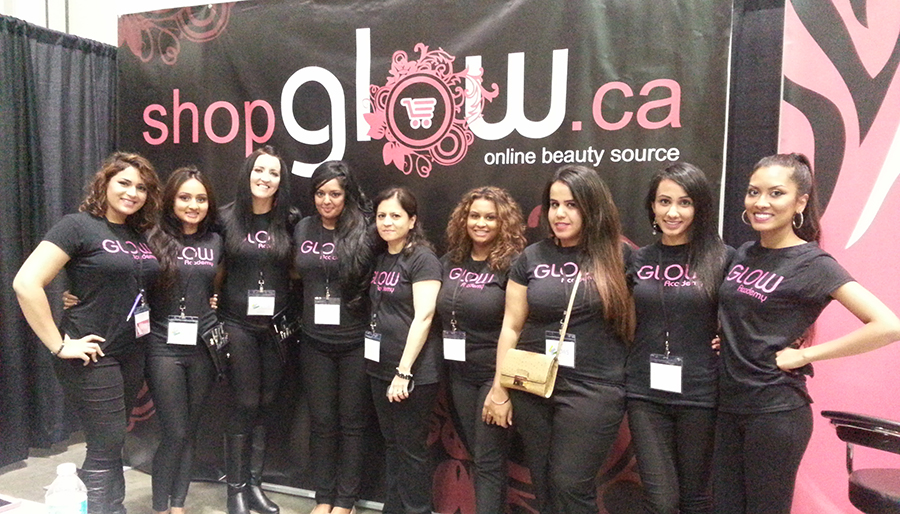 Employees at Glow Academy wearing black custom t-shirts with their company logo.