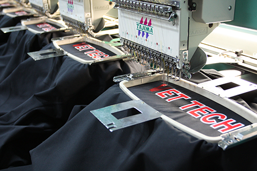 Embroidery machines for custom apparel. Lasting high quality embroidered custom clothing.