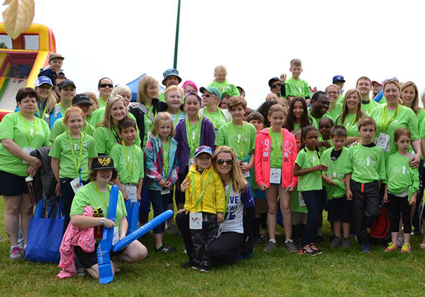 Group of participants in the walk to cure diabetes wearing green custom printed t-shirts.