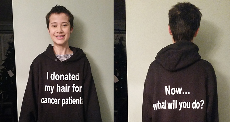 Kaitlyn Johnston wearing a black custom hooded sweatshirt to let others know her hair was donated for cancer.