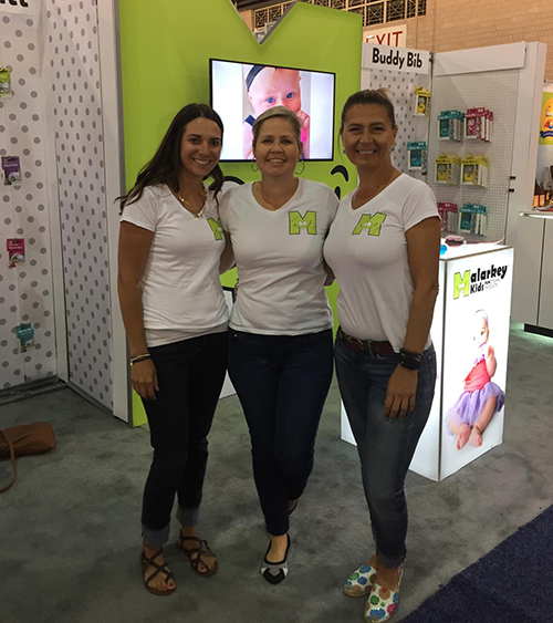 Company showcasing their services at a tradeshow wearing custom t-shirts with their company logo.