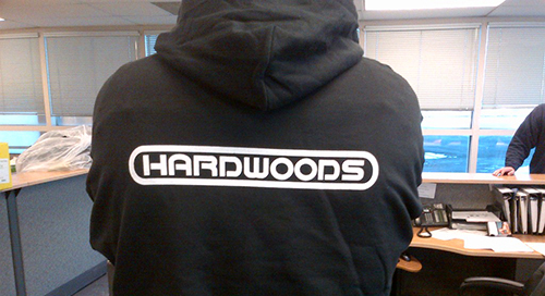Client's customized sweatshirt with company logo. Embroidered hooded sweatshirt with various colours to choose from.