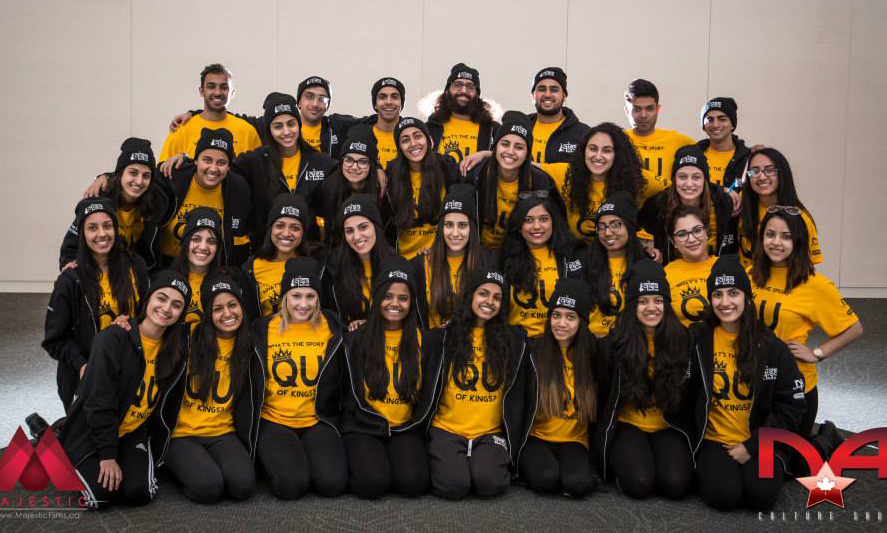 Black embroidered toques representing their university for the dance competition along with mustard colour custom t-shirts.