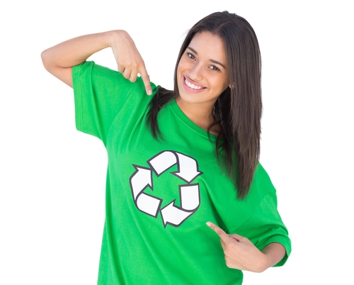A girl wearing a green recycled tshirt