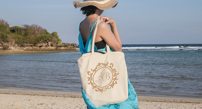 Customized beach tote with personalized logo.