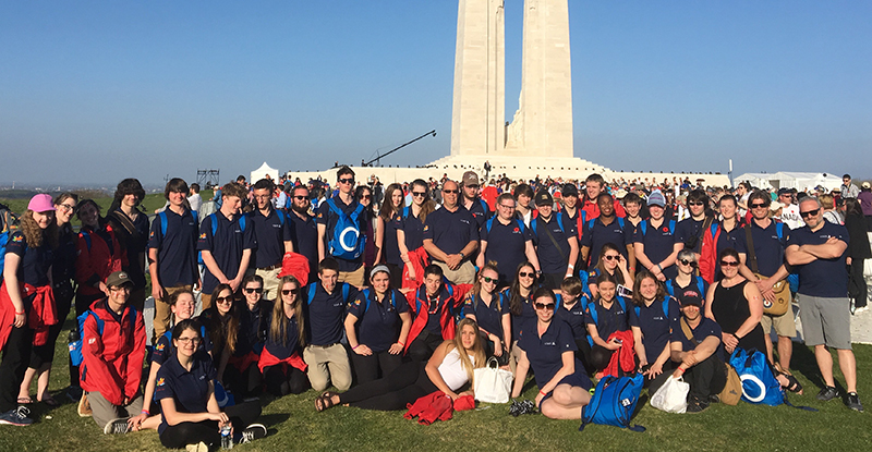 Students wearing navy blue custom polos with Canada 150 logo printed on their sleeves.