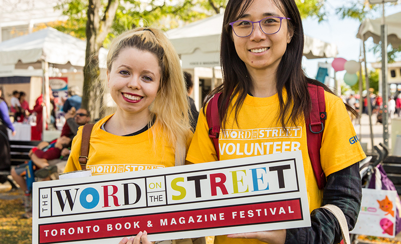 The Word on the Street volunteers wearing yellow custom printed t-shirts at the annual festival.