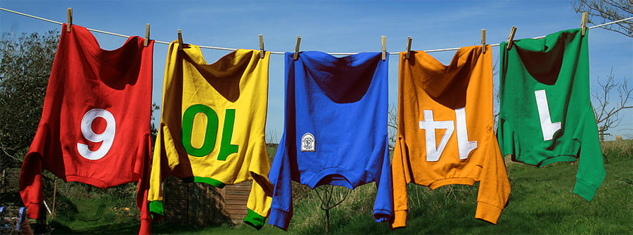 Hanging colourful custom jerseys with personalized numbers and custom logo for teams.