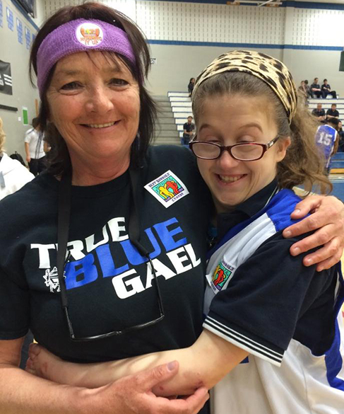 Best Buddies volunteer and student in the non-profit organization program wearing custom t-shirts.
