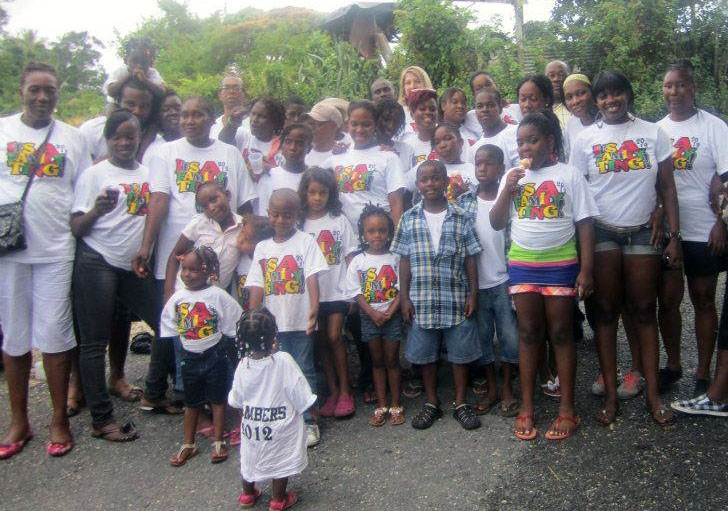 Big group of family members with customized designs on their screen-printed t-shirts.