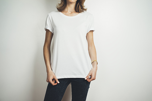 Model wearing white custom printed t-shirt.