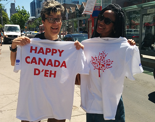 Canada Day custom t-shirts given out to people walking on the street in Toronto.