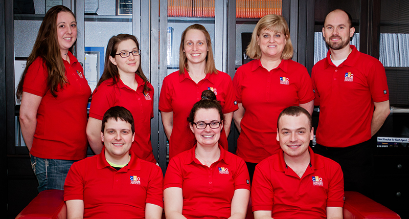 Entripy clients wearing red custom polos for their organization.