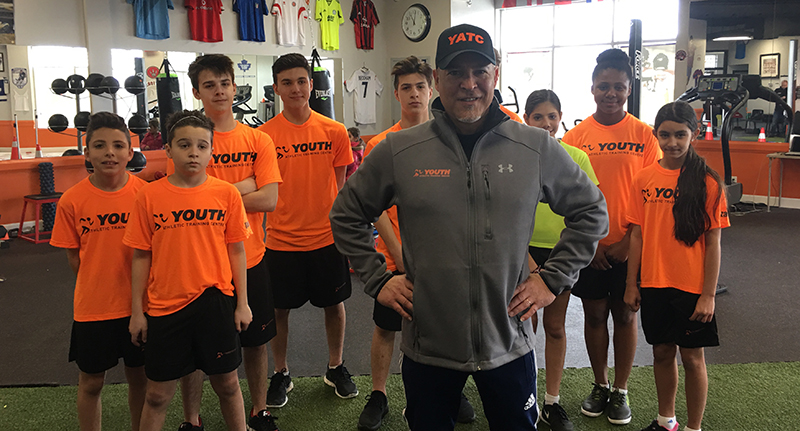 Gym class team wearing custom t-shirts and coach wearing custom hats with Under Armour crewneck.