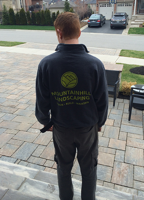 Entripy client wearing customized sweatshirt with company logo.