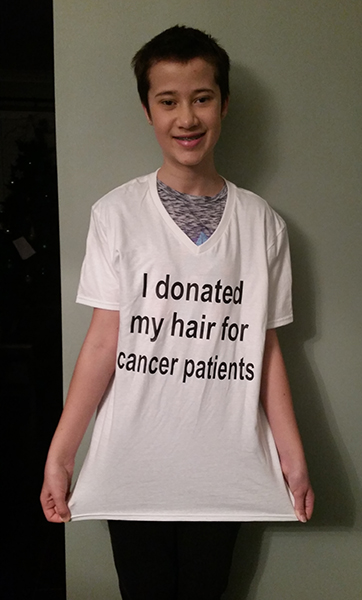 Kaitlyn johnston wearing a white custom t-shirt to bring awareness donating hair for cancer