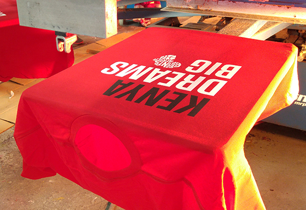 Entripy printing red customized t-shirts for TIFF screening documentary of Giants of Africa.