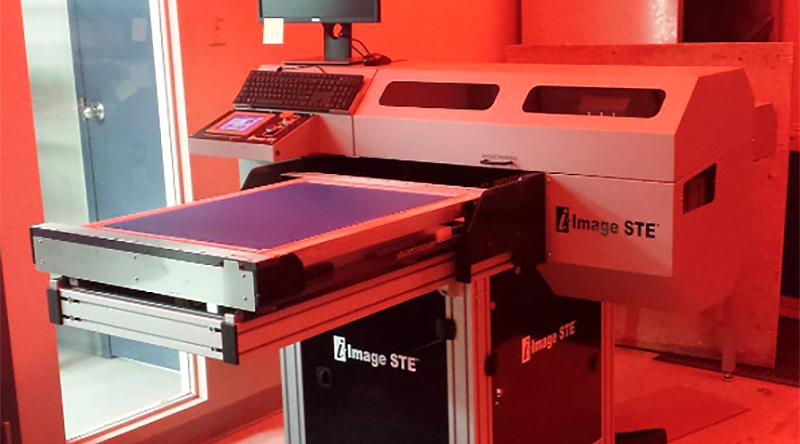 Entripy's new direct-to-screen machine, i-image STE, for all custom apparel orders.