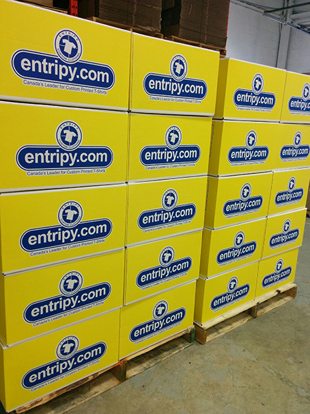 Entripy clients receive yellow boxes with entripy logo for their custom apparel orders.