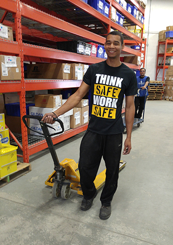Entripy employee wearing custom printed t-shirt in the warehouse.