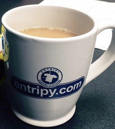 Entripy branded custom mug used as promotional products for giveaways to clients and employees.
