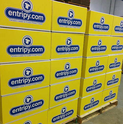 Entripy's yellow box for packaging all custom apparel orders.