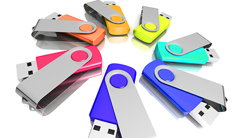 Colourful flash drives used as custom promo products as giveaways for employees or clients.