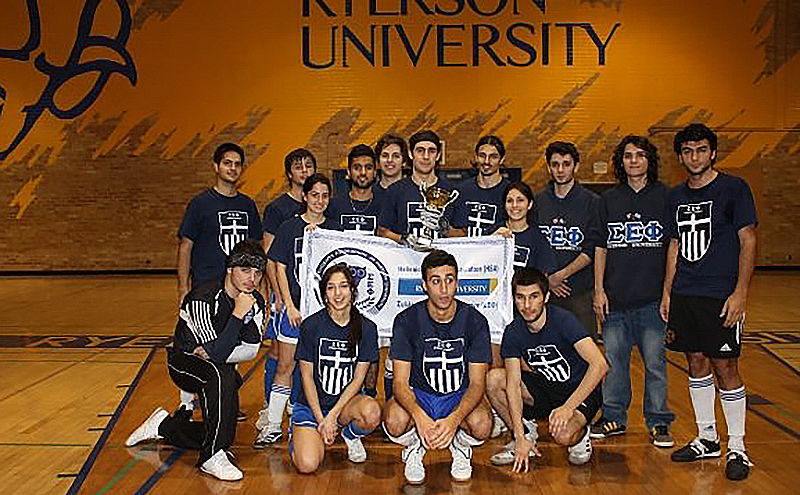 Ryerson University students wearing navy blue custom school t-shirts with their team logo.