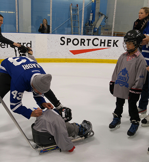 Maple Leafs player Kadri is signing kids custom jerseys at the Easter Seals Skate.