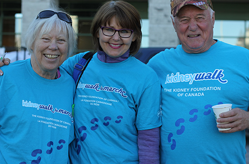 Participants at Kidney Walk charity event displaying sky blue custom printed t-shirts with custom design.