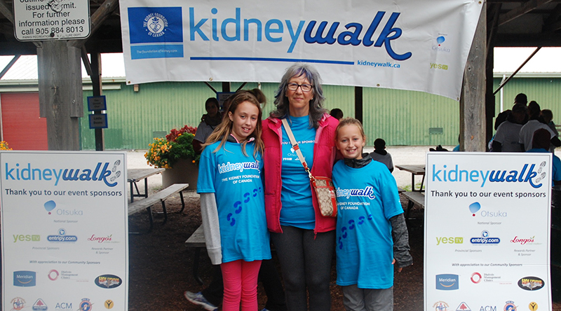 Volunteers wearing custom t-shirts at Kidney Walk charity event.
