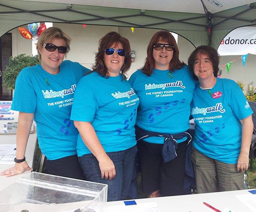 Kidney walk volunteers wearing blue custom t-shirts raising money for the event.