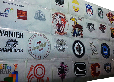 Variety of custom designs printed on custom apparel. Previously designed logos printed as a collage on the wall.