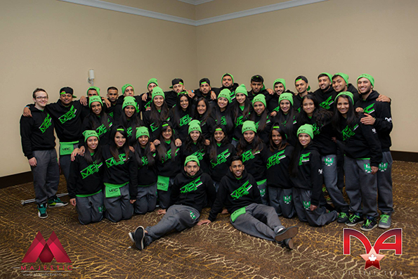 Group of dancers representing their school wearing embroidered toques and custom sweatshirts.