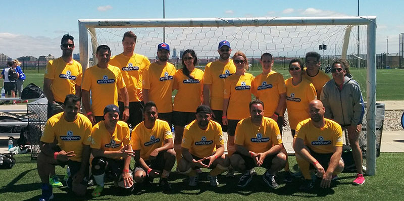 Entripy employees wearing yellow athletic custom printed t-shirts for MLSE Team Up Challenge.
