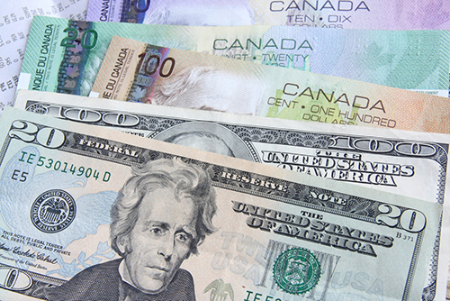 US currency and Canadian dollars depicting the cost savings companies will endure with Entripy.