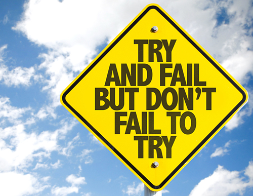 Quote on a sign about trying and not failing.