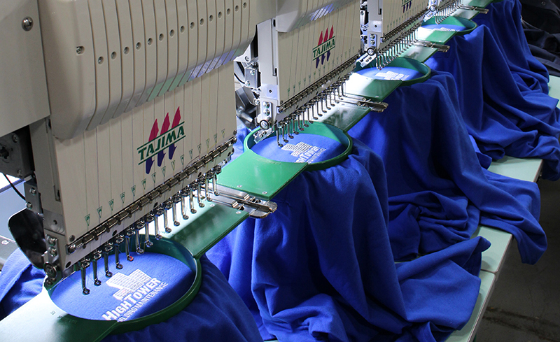 Entripy's new embroidery machine printing custom polo shirts for clients.