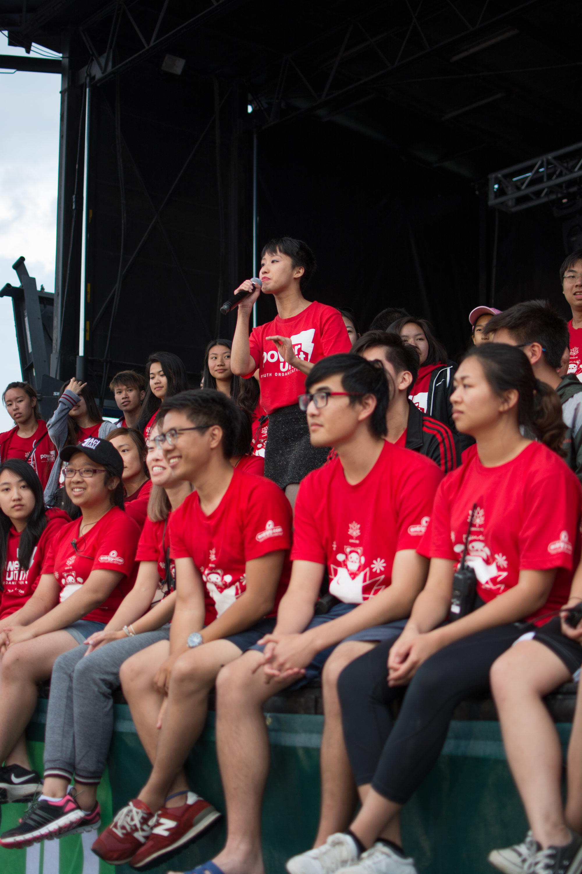Group of participants at a charity event wearing red custom printed t-shirts.