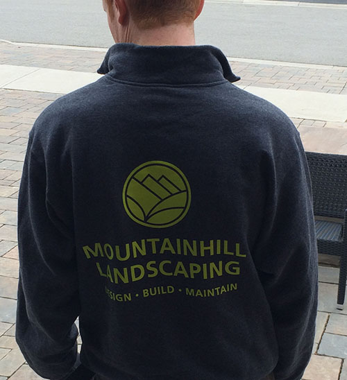 Client wearing custom sweatshirt with company logo printed on full back.