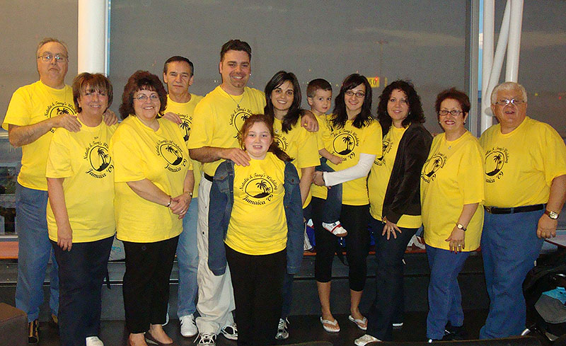 Group of family members at their family reunion with yellow custom t-shirts.